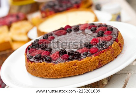 Sweet cakes with berries on table