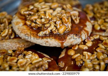 sweet cakes with walnuts caramel - stock photo