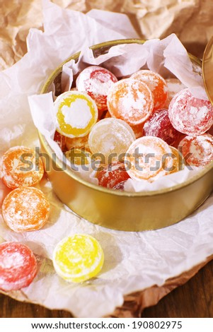 Sweet candies in metal can, close up - stock photo