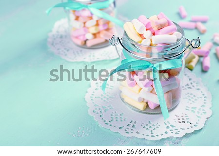 Sweet candies on color wooden table, closeup - stock photo