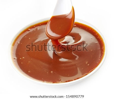 sweet caramel sauce in a white bowl