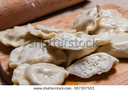 Sweet cheese dumplings on a chopping board. - stock photo