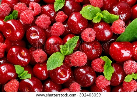 Sweet cherries and raspberries, close-up