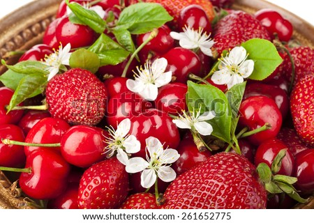Sweet cherries and strawberries flowering collection surface top view close up - stock photo