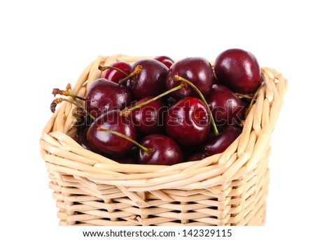 Sweet cherries  in a basket closeup isolated on white - stock photo
