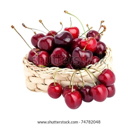 sweet cherries in a basket isolated on white. - stock photo