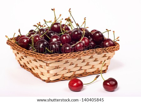 sweet cherries in basket on white