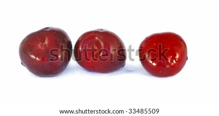Sweet cherries on white bowl close up isolated on white background