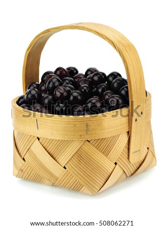 Sweet cherry in basket on a white background