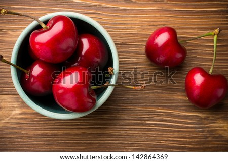 Sweet cherry on a wooden background.