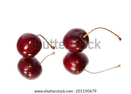 Sweet cherry with reflections in a mirror - stock photo