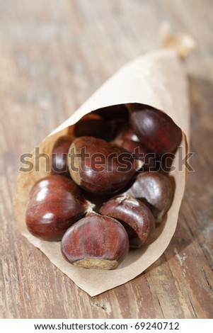 Sweet chestnuts in the paper bag - stock photo