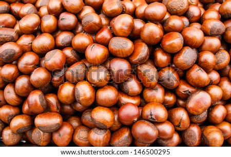 Sweet chestnuts - marron - as background - stock photo