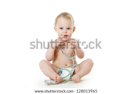 Sweet child with stethoscope on a  white background. - stock photo