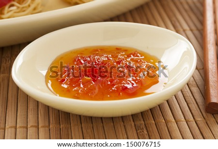 Sweet chilli sauce in a bowl ready to serve. - stock photo