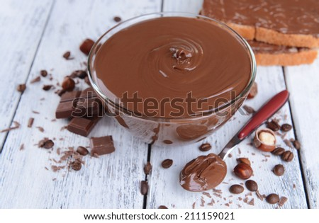 Sweet chocolate cream in bowl on table close-up - stock photo