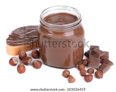 Sweet chocolate cream in jar isolated on white - stock photo