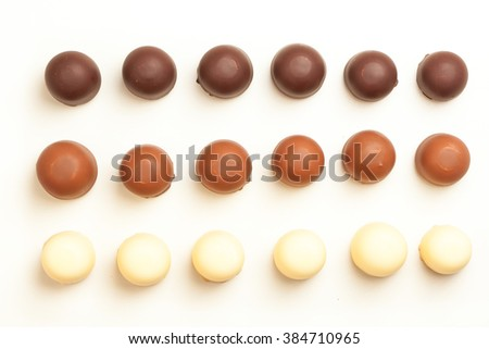 Sweet chocolate cream marshmallows from above, isolated on white background