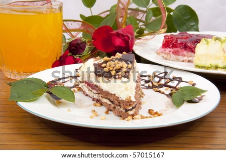 Sweet chocolate dessert with nuts in shape of triangle with juice