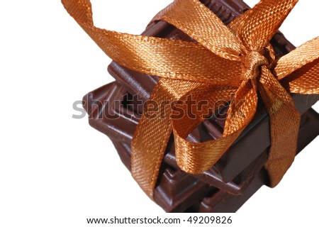 Sweet chocolate present tied with ribbon - stock photo