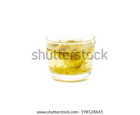 sweet chrysanthemum tea on glass isolated on white.
