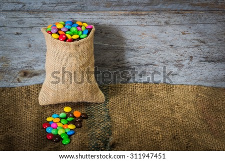 sweet color candy on sackcloth  - stock photo