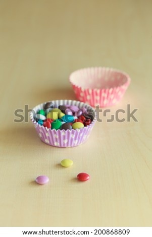 sweet color candy on the wooden background  - stock photo