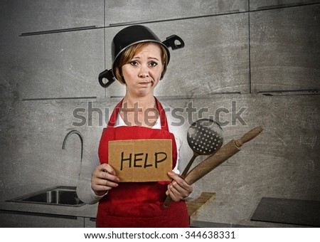 sweet cook woman confused and frustrated face expression wearing red apron asking for help holding rolling pin and cooking pot on the head at home kitchen in domestic stress and lifestyle concept - stock photo