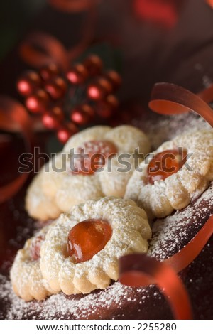 sweet cookies decorated on red background close up