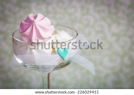 Sweet cookies in a glass bowl. Selective focus on little heart. - stock photo