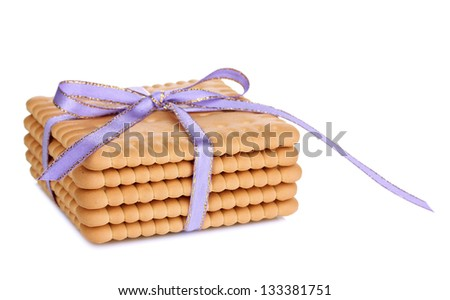 Sweet cookies tied with lilac ribbon isolated on white