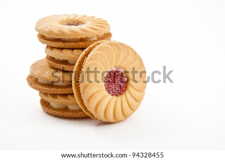 Sweet cookies with jam isolated on white - stock photo