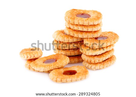 Sweet cookies with jam on gray plate on white background. - stock photo