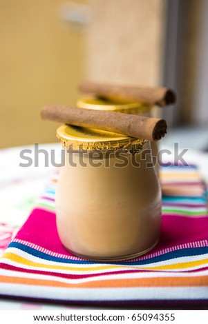 Sweet cookies yogurt with a cinnamon on the striped napkin - stock photo