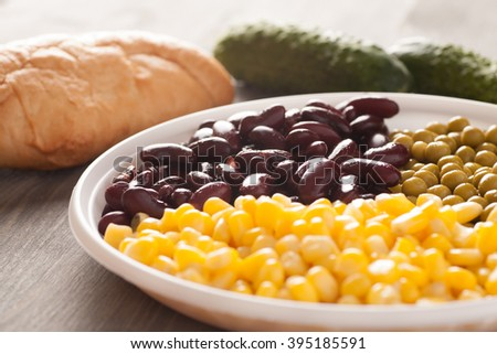 Sweet corn and beans with bread and cucumber, selective focus, closeup macro shot - stock photo