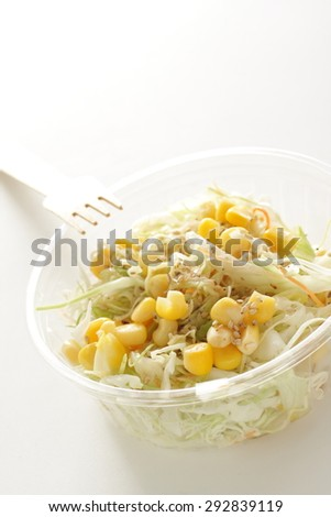 sweet corn and cabbage salad in food container for take out food image - stock photo
