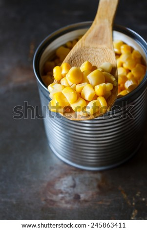 Sweet corn in a can, close up , put on grunge metal tray - stock photo