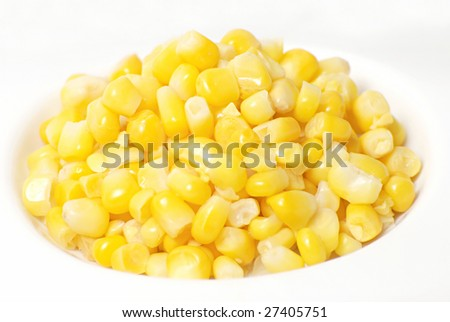 Sweet corn on plate isolated on white - stock photo