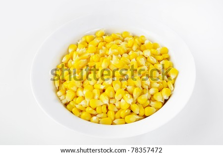 sweet corn seeds in white bowl - stock photo