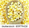 Sweet corn with wooden ladle. - stock photo