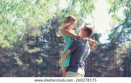 Sweet couple in love, woman and man enjoy each other in sunny spring day  - stock photo