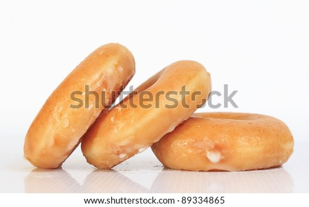Sweet creamy soft brown donuts isolated on white background