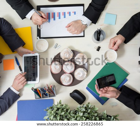 Sweet cupcakes for dessert on business conference - stock photo