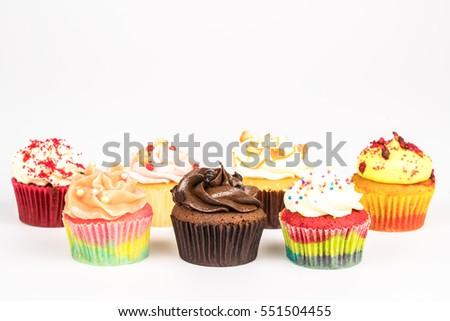 Sweet cupcakes on a white background.
