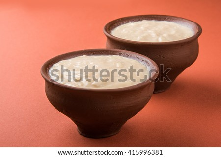 sweet curd or sweet dahi in hindi, served in earthen pot, selective focus - stock photo