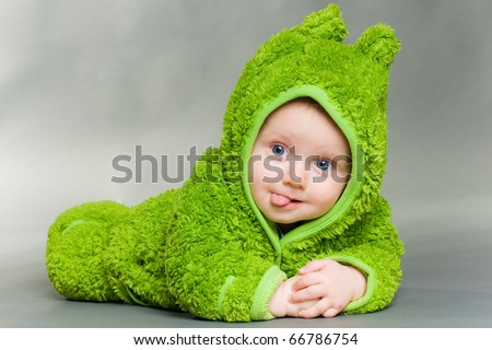 sweet cute baby dressed in a frog suit