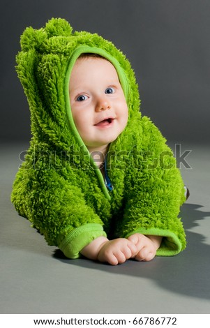 sweet cute baby dressed in a frog suit - stock photo