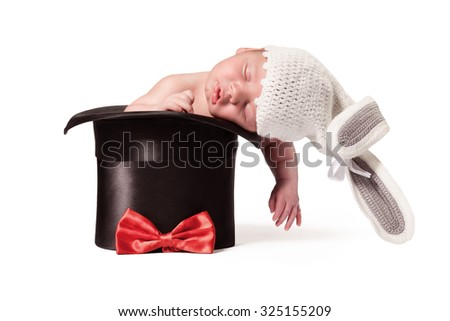 Sweet cute baby in knitted hat with a rabbit ears in the silk hat on the white background - stock photo