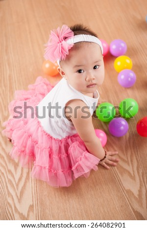 Sweet cute girl Baby smile and sitting on bed at home, asian child