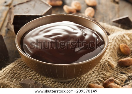 Sweet Dark Chocolate Sauce in a Bowl - stock photo